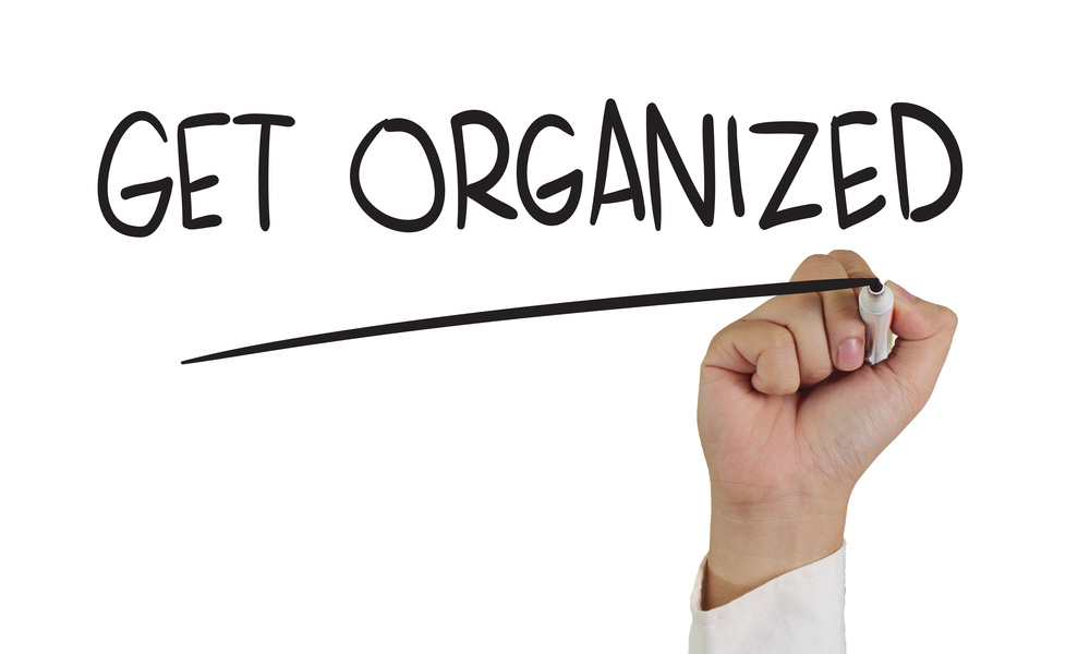 """Get organized"" written in marker"