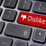 A dislike message on enter keyboard for anti social media concepts