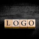Word LOGO. Wooden small cubes with letters isolated on black
