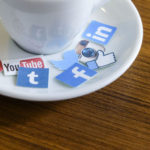 social icons on a coffee saucer
