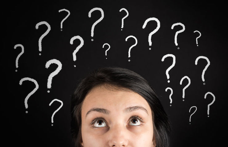 confused woman and question marks