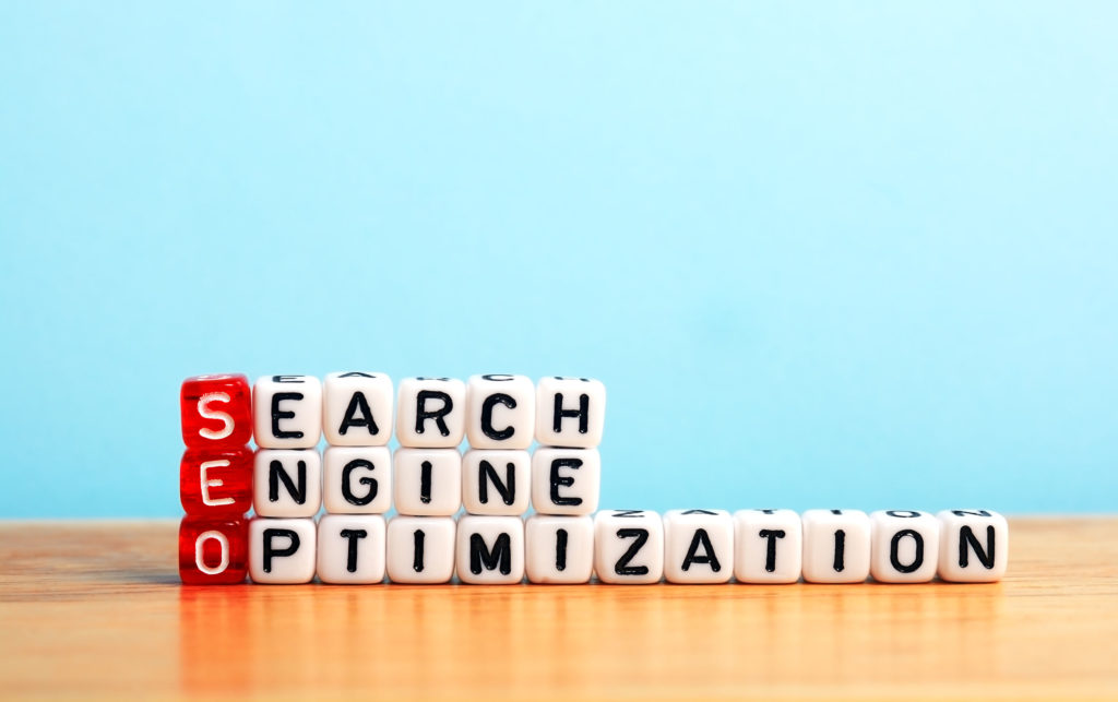 seo search engine optimization written on dices on blue background