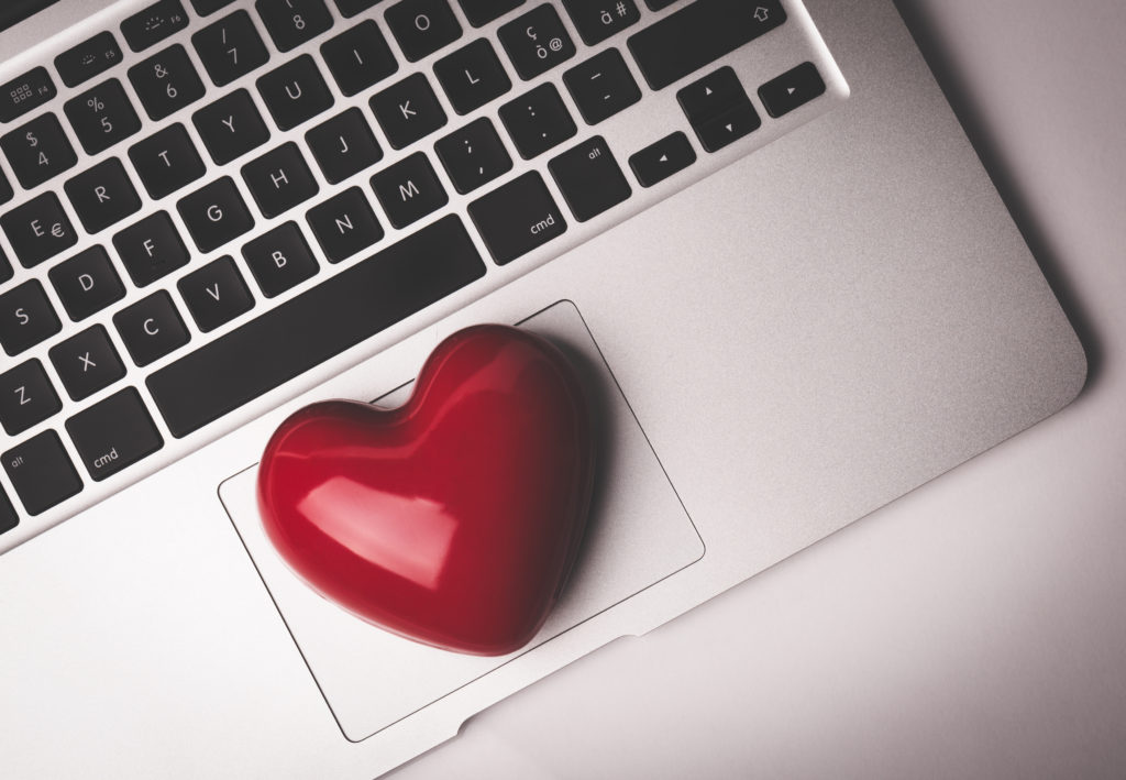 Red heart on laptop keyboard